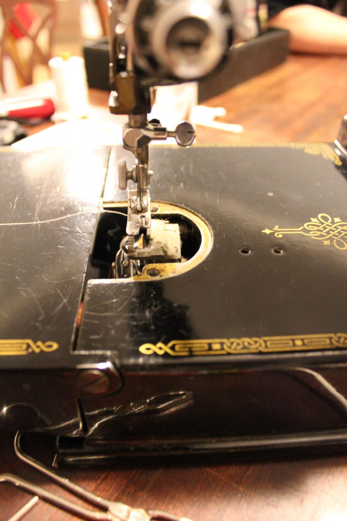 Featherweight dust under the needle plate